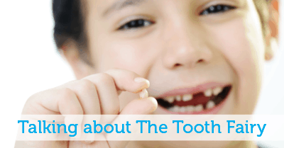 Talking about the Tooth Fairy - little boy holding lost tooth