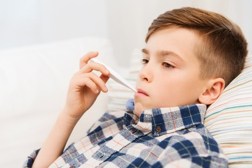 little boy taking temperature