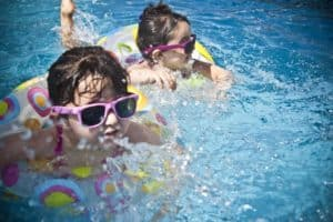 two young girls swimming