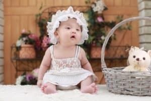adorable baby with bonnet