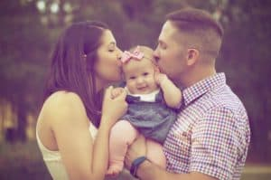 couple with smiling baby