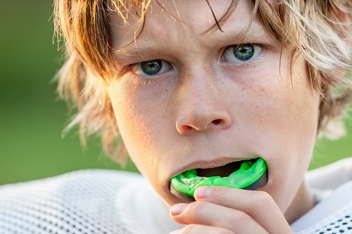boy with mouthguard