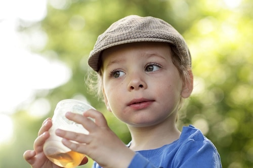 child holding drink