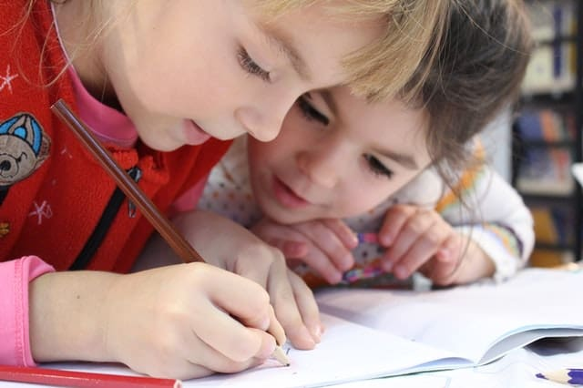 young children doing homework