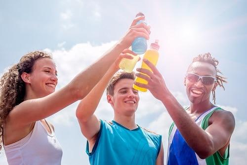 teens drinking sports drinks